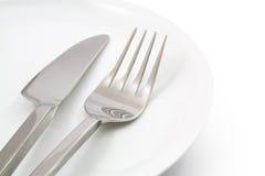 Плита с вилкой и изолированный нож Стоковое Фото
