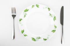 Плита с изображением цветков, ножа и вилки Стоковое Изображение RF