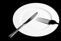 Плита с ножом и не вилкой стоковые фотографии rf