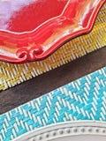 Плиты на таблице Стоковая Фотография