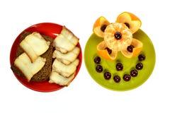 2 плиты прослаивают хлеб с вишнями шпика и tangerine Стоковая Фотография RF