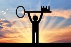 Плоский человек значка держит ключ Стоковое фото RF