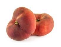 2 плоских персика донута изолированного на белой предпосылке Стоковые Фото