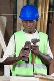 Плотник держа его материал деятельности стоковые фотографии rf