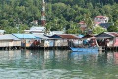 Плохие дома рыболовов морем Стоковые Изображения RF