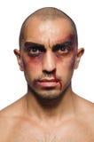 Плохо побитый человек изолированный на белизне Стоковые Изображения RF