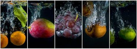 Плодоовощи падая в воду с брызгают и клокочут Стоковые Изображения