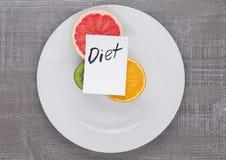 Плодоовощи смешивают киви грейпфрута оранжевый на диете плиты Стоковые Изображения RF