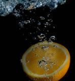 Плодоовощ выплеска апельсина и воды Стоковое Изображение