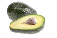 Плодоовощ отрезанного авокадоа изолированного на белой предпосылке Стоковые Фото