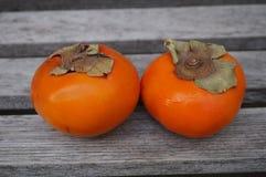 2 плодоовощ kaki хурмы апельсина Стоковые Фото