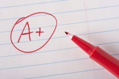 A плюс ранг с ручкой стоковое изображение