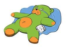 Плюшевый медвежонок лежит в разрывах иллюстрация штока