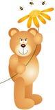 Плюшевый медвежонок держа цветок Стоковые Изображения RF