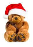 Плюшевый медвежонок нося шляпу santa Стоковое фото RF