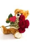 Плюшевый медвежонок с розами и сердцем Стоковое Изображение