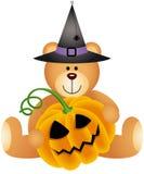 Плюшевый медвежонок хеллоуина с тыквой Стоковая Фотография