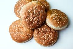 Плюшки бургера на белой предпосылке Стоковые Фото