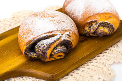 Плюшки с маковыми семененами и сахаром замороженности Стоковые Фото