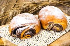 Плюшки с маковыми семененами и сахаром замороженности Стоковая Фотография RF