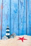 Пляжные домики и маяк Стоковые Изображения