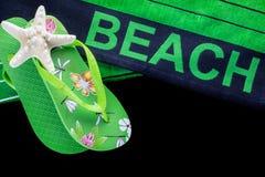 Пляжный полотенце с темповыми сальто сальто Стоковая Фотография
