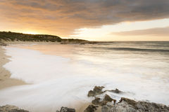 Пляж Австралия захода солнца Стоковые Изображения RF