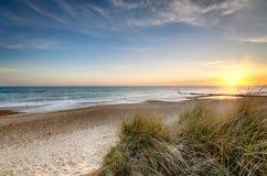 Пляж захода солнца Стоковая Фотография