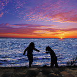 Пляж захода солнца Стоковые Изображения