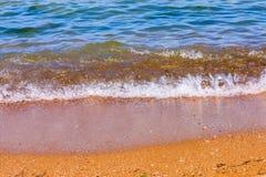 Пляж и волна песка Стоковая Фотография RF