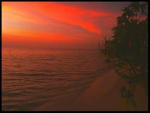 Пляж острова захода солнца Мальдивов Стоковое Фото