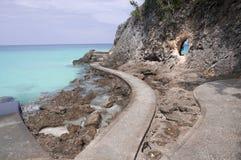 Пляж с утесами в воде Стоковая Фотография