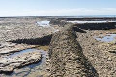 Пляж чистосердечности Punta, расписание дежурств, Кадис, Испания Удя плотина, плотина рыб, Стоковые Изображения