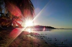 Пляж Thaiti захода солнца стоковое фото rf