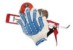 Работайте перчатки и инструменты на белой предпосылке Стоковая Фотография RF