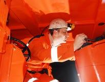 работать горнорабочей тяжелого машинного оборудования Стоковые Фото
