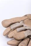 Работая перчатки для защиты над белизной Стоковая Фотография RF
