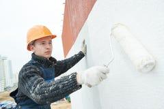 работа колеривщика фасада строителя Стоковая Фотография