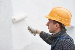 работа колеривщика фасада строителя Стоковые Фотографии RF