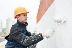 работа колеривщика фасада строителя Стоковые Фото