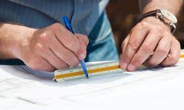 работа планов строительства стоковое изображение