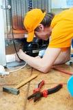 работа ремонта холодильника прибора стоковая фотография rf