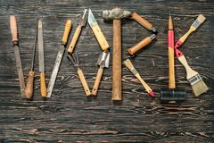 РАБОТА текста написана инструментами работы Слово РАБОТА составлено инструментов работы Стоковые Изображения