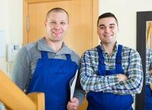 2 работника на пороге Стоковое Изображение RF