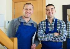 2 работника на пороге Стоковое Изображение