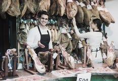 2 работника продавая jamon Стоковые Изображения RF