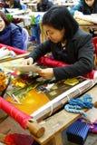 Работники вышивают с шелком Стоковое фото RF