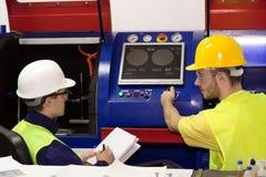 Работники для пульта управления машины Стоковое фото RF