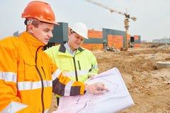 Работники построителя на строительной площадке Стоковое Изображение RF