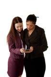 Работники смотря телефон Стоковая Фотография